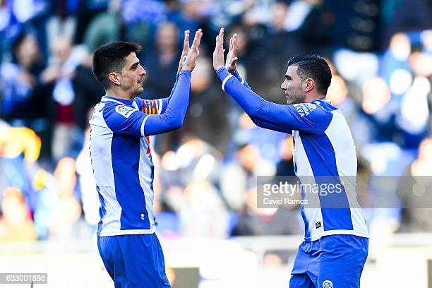 Jose Antonio Reyes of RCD Espanyol celebrates with his team mate Gerard Moreno of RCD Espanyol after scoring his team's first goal from the penalty...
