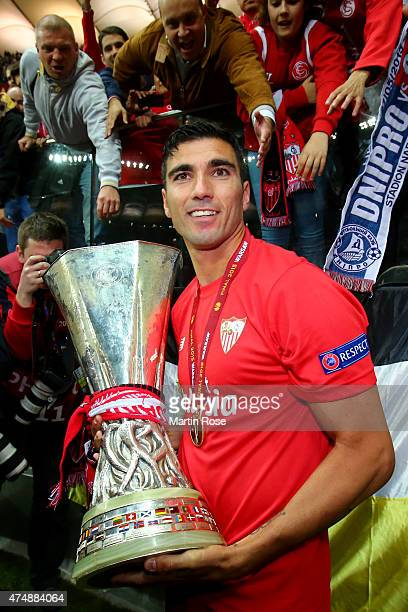 Jose Antonio Reyes of Sevilla holds the trophy as he celebrates victory after the UEFA Europa League Final match between FC Dnipro Dnipropetrovsk and...