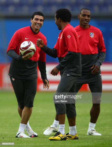 Jose Antonio Reyes shares a joke with his team mates the Atletico Madrid training session ahead of the UEFA Europa League final match against Fulham...