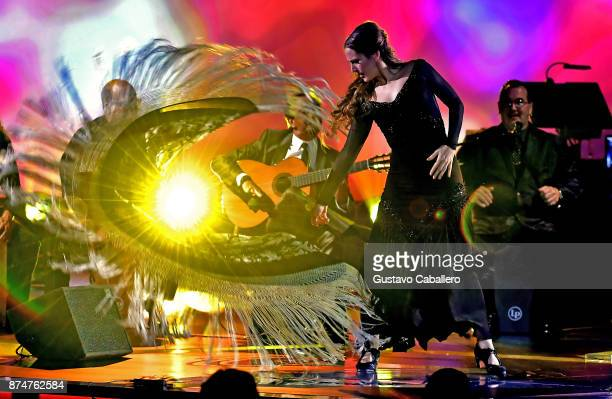 Jose Antonio Rodriguez and dancer Siudy Garrido perform onstage during the 2017 Person of the Year Gala honoring Alejandro Sanz at the Mandalay Bay...