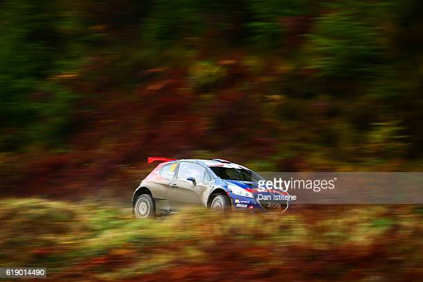 Jose Antonio Suarez Miranda of Spain and Peugeot Rally Academy drives with codriver Candido Carrera Estevez of Spain and Peugeot Rally Academy during...