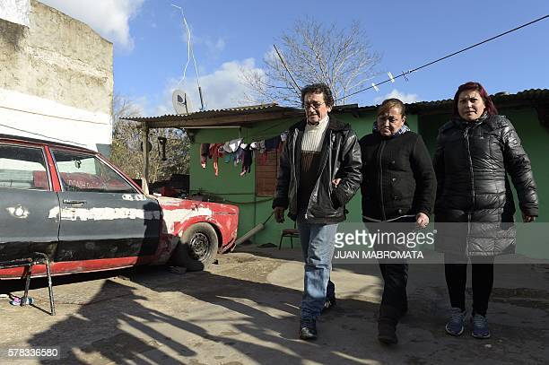 Jose Arias Maria Reynoso and their daughter Isabel leave their home to visit the grave of their daughter Karen in La Matanza Buenos Aires province on...