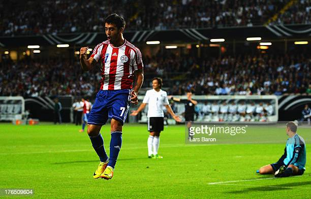 Jose Ariel Nunez of Paraguay celebrates after scoring his teams first goal during the international friendly match between Germany and Paraguay at...