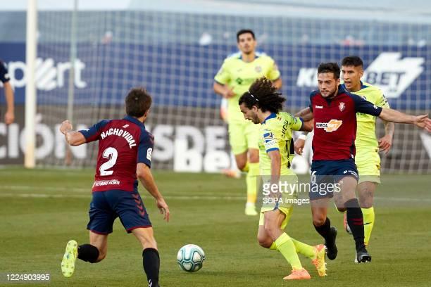 Jose Arnaiz and Marc Cucurella Saseta Nacho Vidal in action during the Spanish La Liga Santander match between CA Osasuna and Getafe CF at the Sadar...
