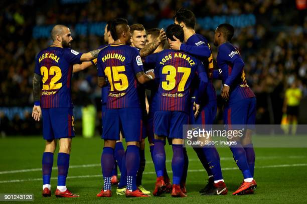 Jose Arnaiz of FC Barcelona celebrates with his teammates after scoring his team's first goal during the Copa del Rey Round of 16 first Leg match...