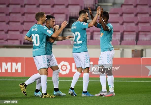 Jose Arnaiz of Osasuna celebrates with teammates after scoring his team's first goal during the Liga match between FC Barcelona and CA Osasuna at...