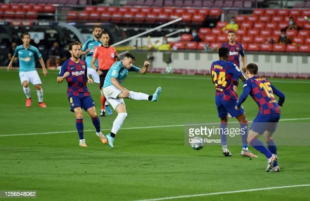 Jose Arnaiz of Osasuna scores his team's first goal during the Liga match between FC Barcelona and CA Osasuna at Camp Nou on July 16, 2020 in...