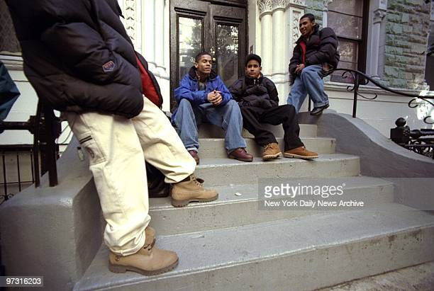 Jose Arroyo William Capo Noel Vasquez and Carlos Gagot show that baggy jeans are in style across the street from the High School of Fashions...