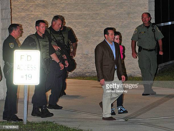 Jose Baez and Casey Anthony leave the Orange County Jail after her midnight release on July 17, 2011 in Orlando, Florida.