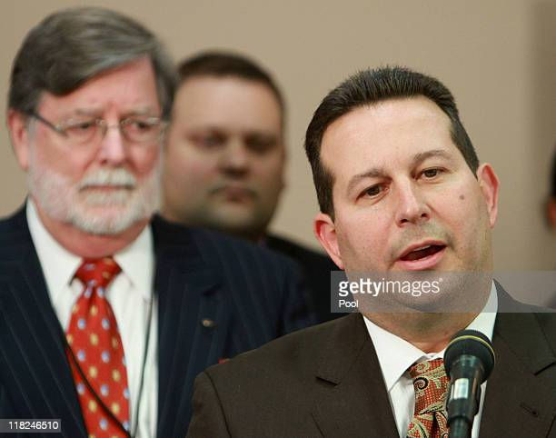 Jose Baez, lead defense counsel for Casey Anthony, answers questions as co-counsel Cheney Mason looks on after his client was found not guilty in her...