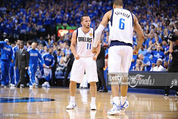 Jose Barea and Tyson Chandler of the Dallas Mavericks react to a play against the Miami Heat during Game Five of the 2011 NBA Finals on June 9, 2011...