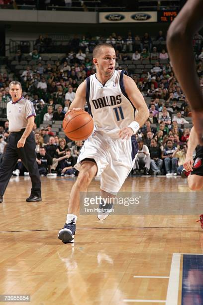 Jose Barea of the Dallas Mavericks moves the ball against Sergio Rodriguez of the Portland Trailblazers during the game at American Airlines Center...