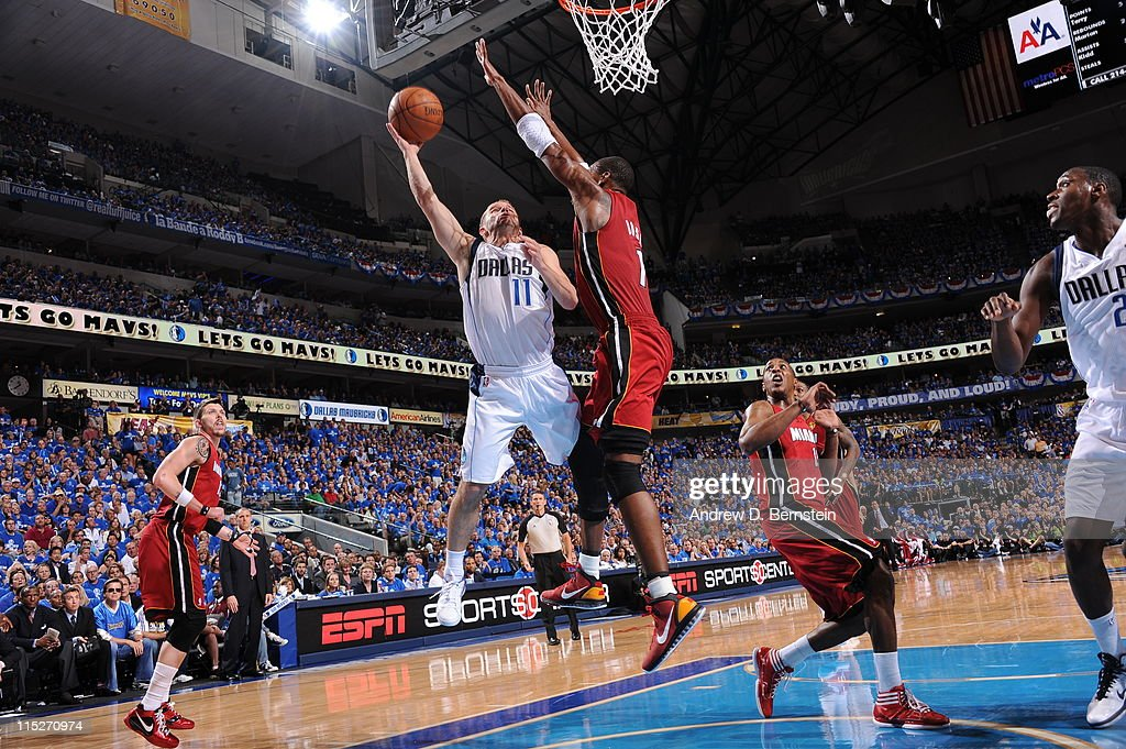 Jose Barea of the Dallas Mavericks shoots against Chris Bosh