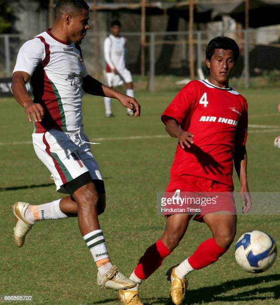 Jose Barreto of Mohun Bagan fights for the possessiion of the ball with Air India's Syed Farid during their I League football match at Cooperage on...