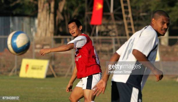 Jose Barretto avoids a ball hit by Bhaichung Bhutia during Mohun Bagan's practice at Cooperage on Saturday