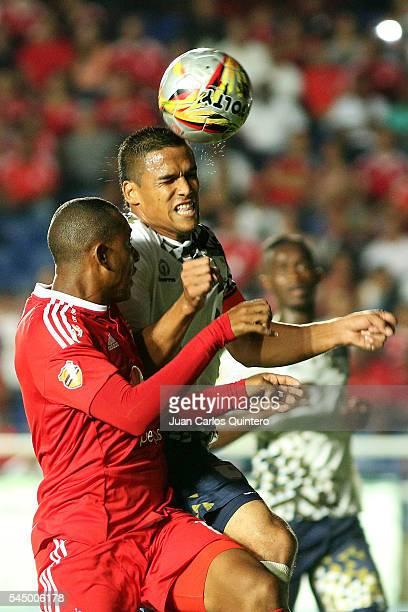 Jose Barriosnuevo of Atletico FC and Alejandro Peñaranda of America de Cali jump for a header during a match between Atletico FC and America de Cali...