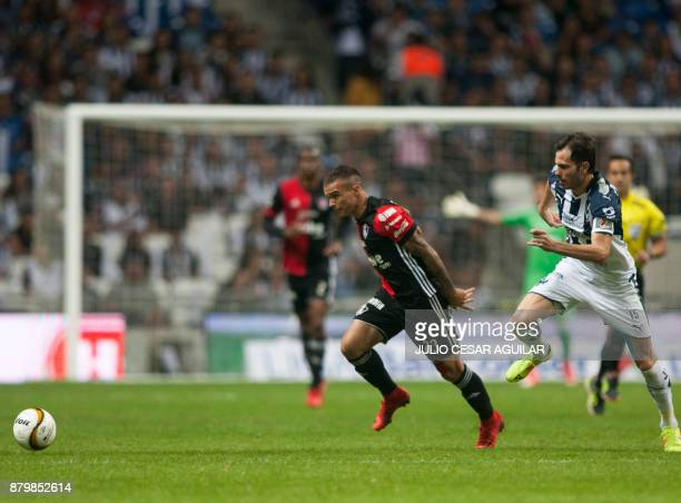 Jose Basanta of Monterrey vies for the ball with Christian Tabo of Atlas during their quarter final Mexican Apertura 2017 tournament football match...