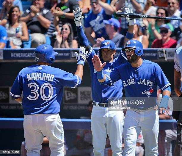 TORONTO ON JULY 24 Jose Bautista and Dioner Navarro of the Toronto Blue Jays score on single by Juan Francisco in the 5th inning to make it 70...