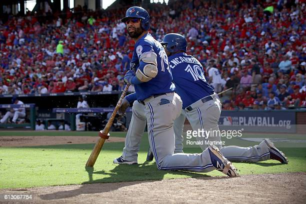 Jose Bautista and Edwin Encarnacion of the Toronto Blue Jays look on in the third inning against the Texas Rangers during game one of the American...