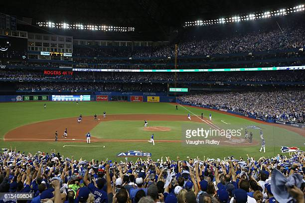Jose Bautista and Ryan Goins of the Toronto Blue Jays score off of an RBI double hit by Edwin Encarnacion in the seventh inning against Bryan Shaw of...