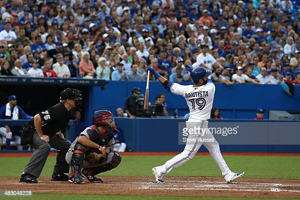 Jose Bautista, Eric Fryer and umpire Tom Woodring watch as his ball clears the wall for a grand slam as the Toronto Blue Jays play the Minnesota...