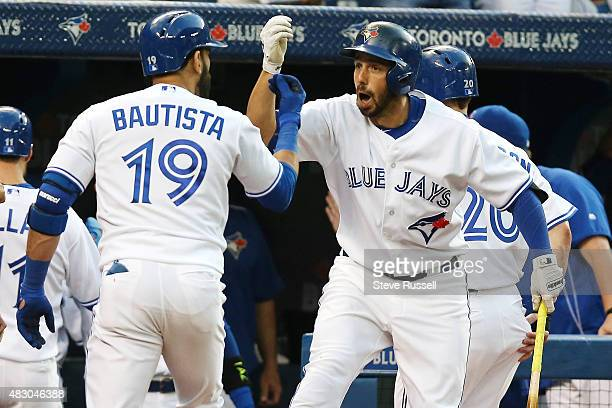 TORONTO ON AUGUST 5 Jose Bautista is congratulated on his grand slam by Chris Colabello as the Toronto Blue Jays play the Minnesota Twins at the...