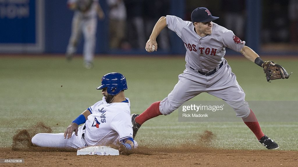 TORONTO - AUGUST 25 - Jose Bautista is out at 2nd but SS Brock Holt can't get the throw to 1st in time for a double play ball. Toronto Blue Jays Vs Boston Red Sox during MLB action at Rogers Centre on August 25, 2014. Jays lost 4-3 in 10 innings.