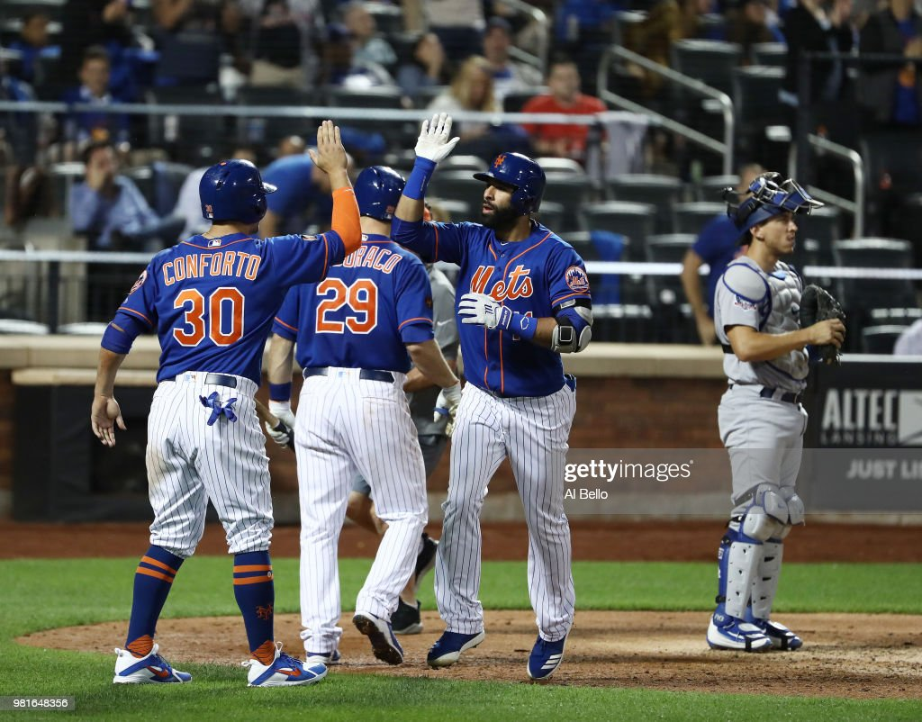 Jose Bautista #11 of the New York Mets celebrates after hitting a two run home run in the seventh inning against the Los Angeles Dodgers during their game at Citi Field on June 22, 2018 in New York City.