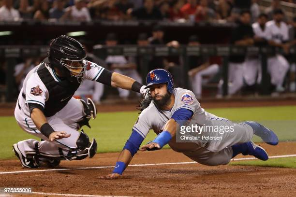 Jose Bautista of the New York Mets is tagged out by catcher Alex Avila of the Arizona Diamondbacks attempting to score a run during the second inning...