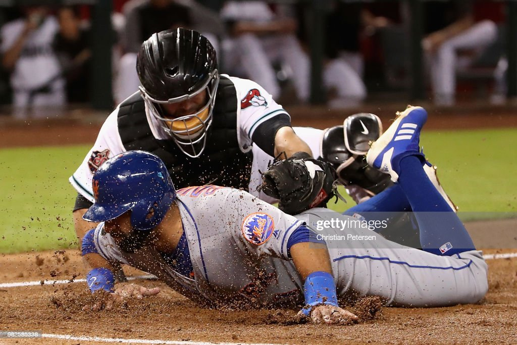 Jose Bautista #11 of the New York Mets is tagged out by catcher Alex Avila #5 of the Arizona Diamondbacks attempting to score a run during the second inning of the MLB game at Chase Field on June 15, 2018 in Phoenix, Arizona.