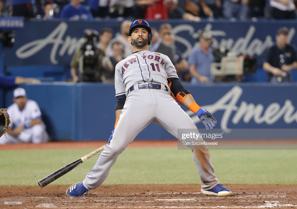 Jose Bautista #11 of the New York Mets reacts to a high inside pitch in the ninth inning during MLB game action against the Toronto Blue Jays at Rogers Centre on July 3, 2018 in Toronto, Canada.