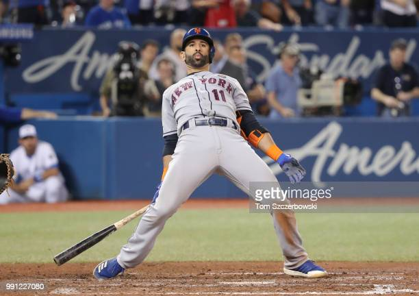 Jose Bautista of the New York Mets reacts to a high inside pitch in the ninth inning during MLB game action against the Toronto Blue Jays at Rogers...