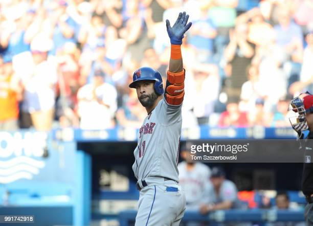 Jose Bautista of the New York Mets salutes the fans ovation as he steps up to bat in the first inning during MLB game action against the Toronto Blue...