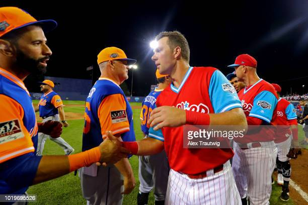 Jose Bautista of the New York Mets shakes hands with Rhys Hoskins of the Philadelphia Phillies after the 2018 Little League Classic at Historic...
