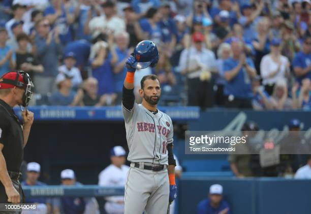 Jose Bautista of the New York Mets slautes the fans as he doffs his helmet as he comes up to bat in the first inning during MLB game action against...