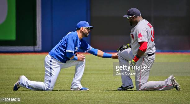 TORONTO ON JULY 24 Jose Bautista of the Toronto Blue Jays and David Ortiz of the Boston Red Sox talk together in the outfield before the gameToronto...