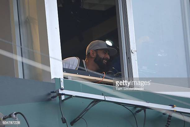 Jose Bautista of the Toronto Blue Jays announces the name of the batter over the public address system as he serves his onegame suspension during MLB...