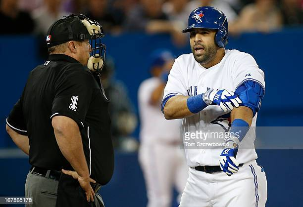 Jose Bautista of the Toronto Blue Jays argues a called strikeout to home plate umpire Bruce Dreckman in the sixth inning during MLB game action...