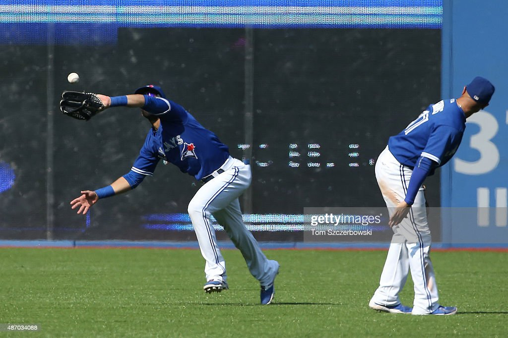 Jose Bautista #19 of the Toronto Blue Jays catches a fly ball in the ninth inning during MLB game action against the Baltimore Orioles on September 5, 2015 at Rogers Centre in Toronto, Ontario, Canada.