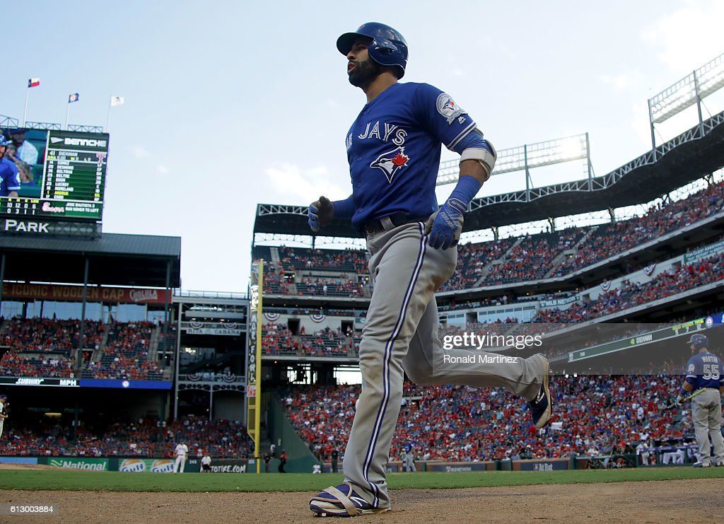 Jose Bautista #19 of the Toronto Blue Jays celebrates after hitting a three run home run to left field against Jake Diekman #41 of the Texas Rangers during the ninth inning in game one of the American League Divison Series at Globe Life Park in Arlington on October 6, 2016 in Arlington, Texas.