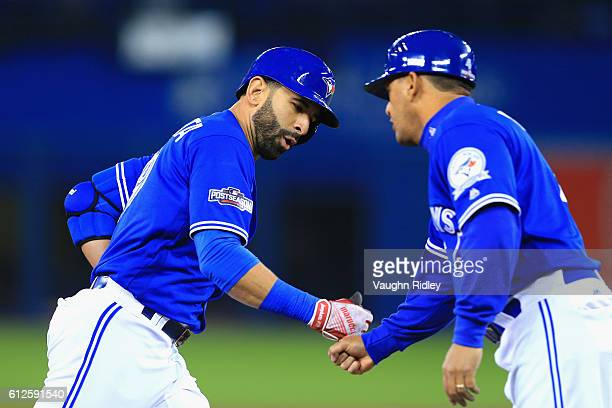 Jose Bautista of the Toronto Blue Jays celebrates as he runs the bases after hitting a solo home run in the second inning against the Baltimore...