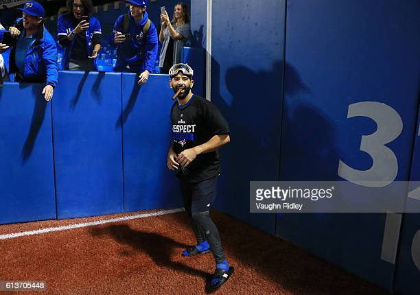 Jose Bautista of the Toronto Blue Jays celebrates with fans after the Toronto Blue Jays defeated the Texas Rangers 76 for game three of the American...