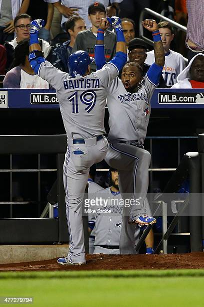 Jose Bautista of the Toronto Blue Jays celebrates with Jose Reyes after hitting a gametying home run in the ninth inning against the New York Mets at...
