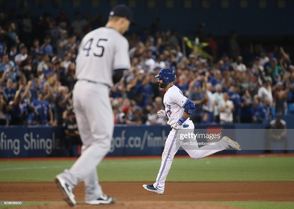 Jose Bautista #19 of the Toronto Blue Jays circles the bases after hitting a solo home run in the seventh inning during MLB game as Chasen Shreve #45 of the New York Yankees looks on at Rogers Centre on August 10, 2017 in Toronto, Canada.