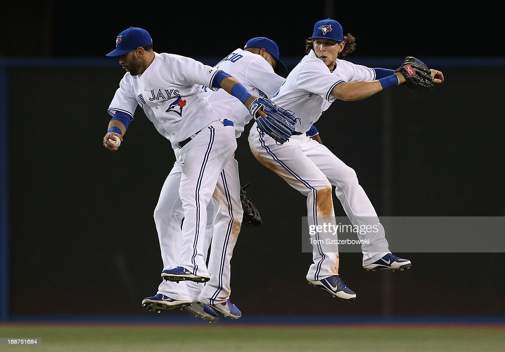 Jose Bautista #19 of the Toronto Blue Jays clebrates their victory with Emilio Bonifacio #1 and Colby Rasmus #28 during MLB game action against the San Francisco Giants on May 14, 2013 at Rogers Centre in Toronto, Ontario, Canada.