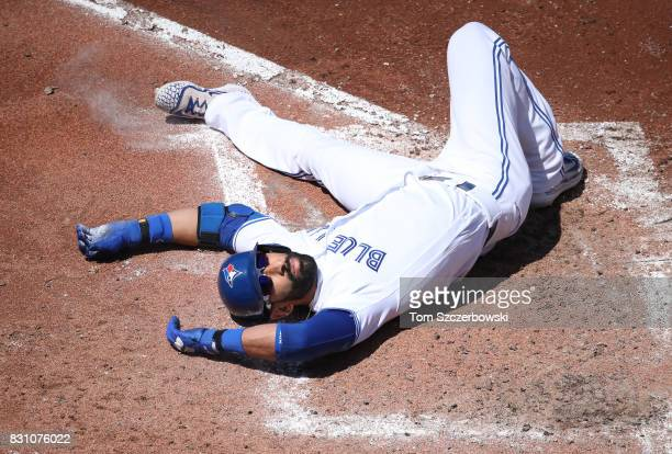 Jose Bautista of the Toronto Blue Jays falls to the dirt after being brushed back by a high and inside pitch in the fourth inning during MLB game...