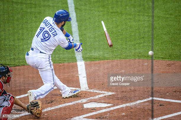 TORONTO ON MAY 8 Jose Bautista of the Toronto Blue Jays gets a broken back single during the game between the Toronto Blue Jays and the Boston Red...
