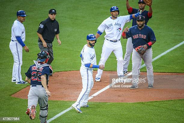 Jose Bautista of the Toronto Blue Jays gets get caught in a rundown by catcher Blake Swihart of the Boston Red Sox on a fielders choice on a Russell...