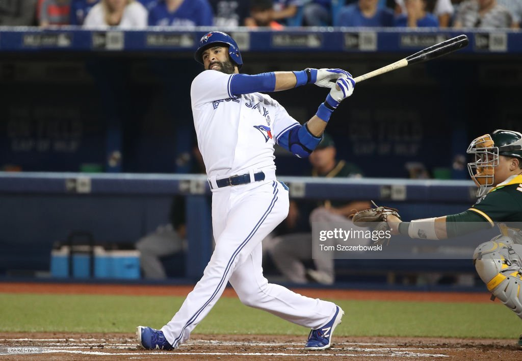 Jose Bautista #19 of the Toronto Blue Jays hits a double in the first inning during MLB game action against the Oakland Athletics at Rogers Centre on July 26, 2017 in Toronto, Canada.