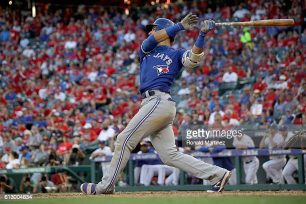 Jose Bautista of the Toronto Blue Jays hits a three run home run to left field against Jake Diekman of the Texas Rangers during the ninth inning in...